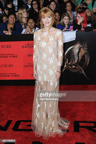 Actress Bella Thorne arrives at the Los Angeles Premiere of 'The Hunger Games Catching Fire' at Nokia Theatre LA Live on November 18 2013 in Los...