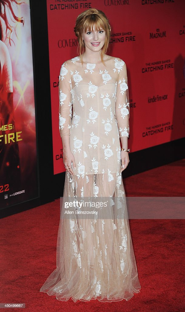 Actress Bella Thorne arrives at the Los Angeles Premiere of 'The Hunger Games: Catching Fire' at Nokia Theatre L.A. Live on November 18, 2013 in Los Angeles, California.