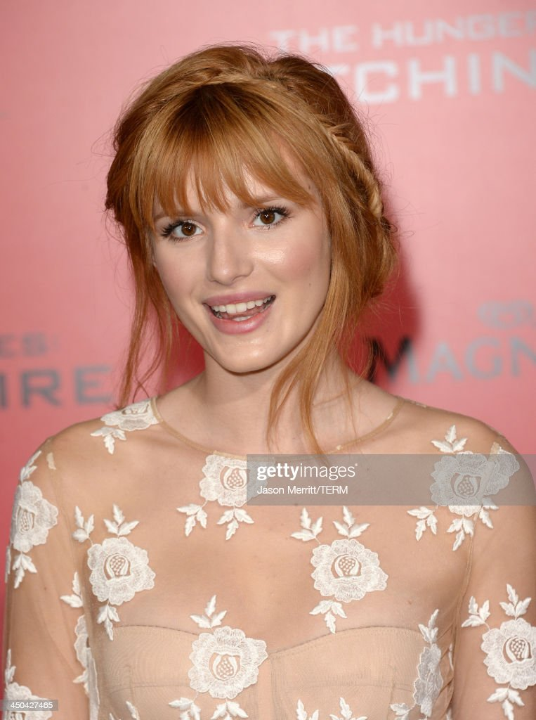 Actress Bella Thorne arrives at the premiere of Lionsgate's 'The Hunger Games: Catching Fire' at Nokia Theatre L.A. Live on November 18, 2013 in Los Angeles, California.