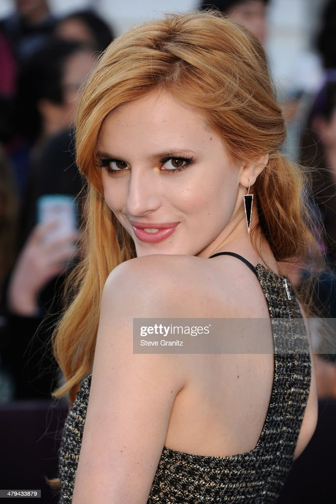 Actress Bella Thorne arrives at the premiere of Summit Entertainment's 'Divergent' at the Regency Bruin Theatre on March 18, 2014 in Los Angeles, California.