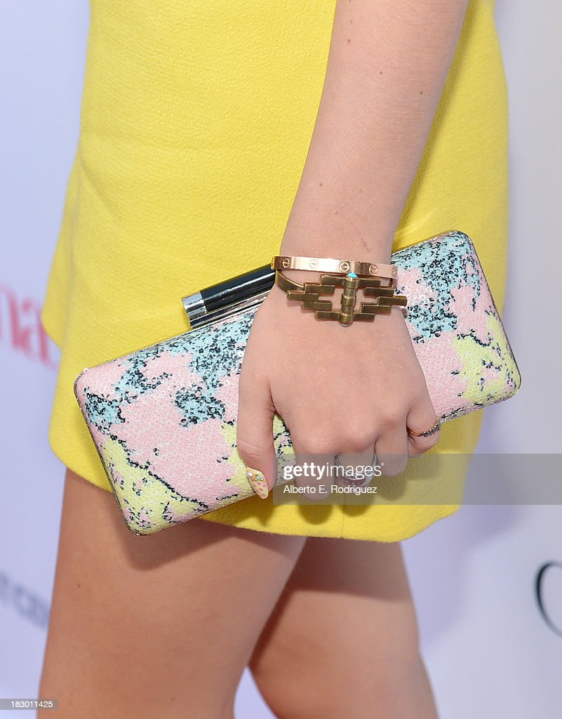 Actress Bella Thorne (handbag detail) attends Latina Magazine's 'Hollywood Hot List' party at The Redbury Hotel on October 3, 2013 in Hollywood, California.