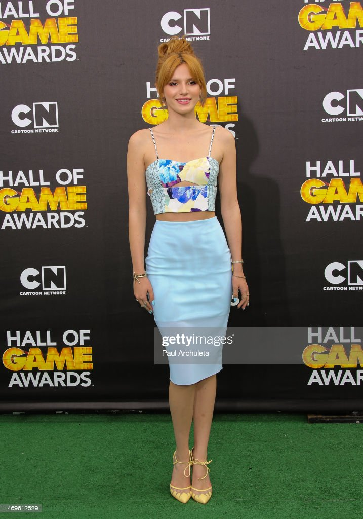 Actress <a gi-track='captionPersonalityLinkClicked' href=/galleries/search?phrase=Bella+Thorne&family=editorial&specificpeople=5083663 ng-click='$event.stopPropagation()'>Bella Thorne</a> attends the Cartoon Network's Hall Of Game Awards at Barker Hangar on February 15, 2014 in Santa Monica, California.