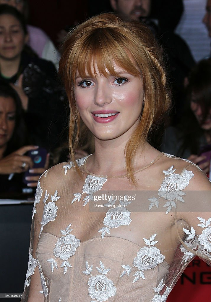 Actress <a gi-track='captionPersonalityLinkClicked' href=/galleries/search?phrase=Bella+Thorne&family=editorial&specificpeople=5083663 ng-click='$event.stopPropagation()'>Bella Thorne</a> attends the premiere of Lionsgate's 'The Hunger Games: Catching Fire' at Nokia Theatre L.A. Live on November 18, 2013 in Los Angeles, California.