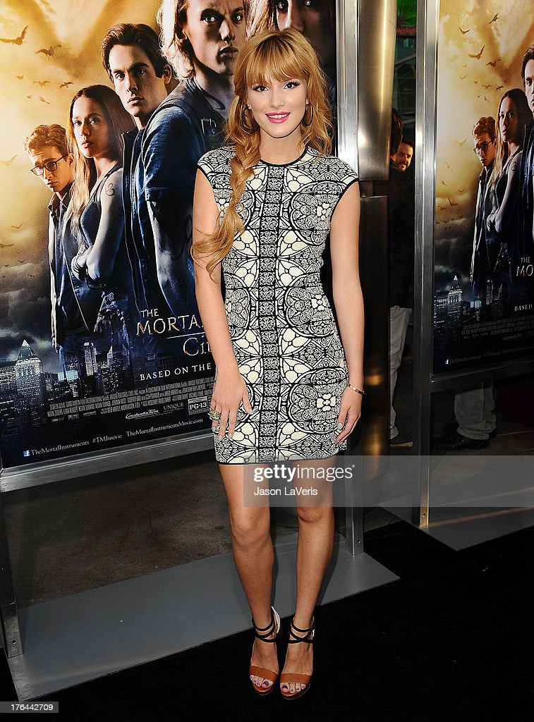 Actress <a gi-track='captionPersonalityLinkClicked' href=/galleries/search?phrase=Bella+Thorne&family=editorial&specificpeople=5083663 ng-click='$event.stopPropagation()'>Bella Thorne</a> attends the premiere of 'The Mortal Instruments: City Of Bones' at ArcLight Cinemas Cinerama Dome on August 12, 2013 in Hollywood, California.