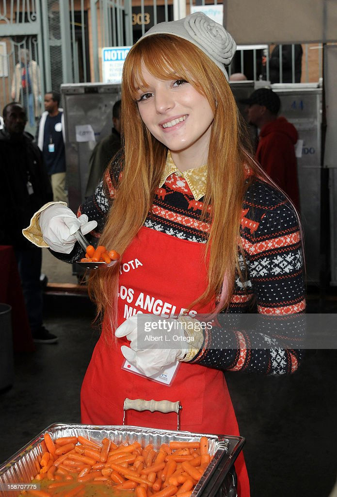 Actress Bella Thorne participates in the Los Angeles Mission Christmas Eve lunch For The Homeless held at the Los Angeles Mission on December 24, 2012 in Los Angeles, California.