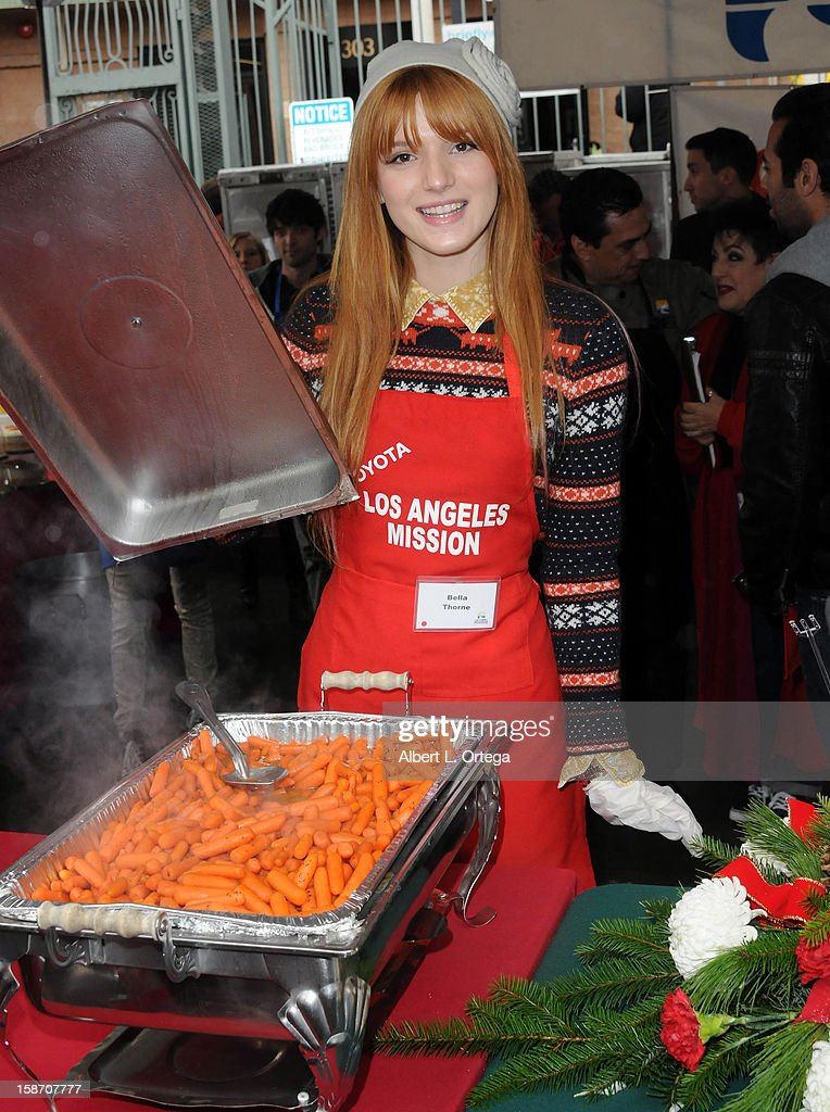 Actress <a gi-track='captionPersonalityLinkClicked' href=/galleries/search?phrase=Bella+Thorne&family=editorial&specificpeople=5083663 ng-click='$event.stopPropagation()'>Bella Thorne</a> participates in the Los Angeles Mission Christmas Eve lunch For The Homeless held at the Los Angeles Mission on December 24, 2012 in Los Angeles, California.