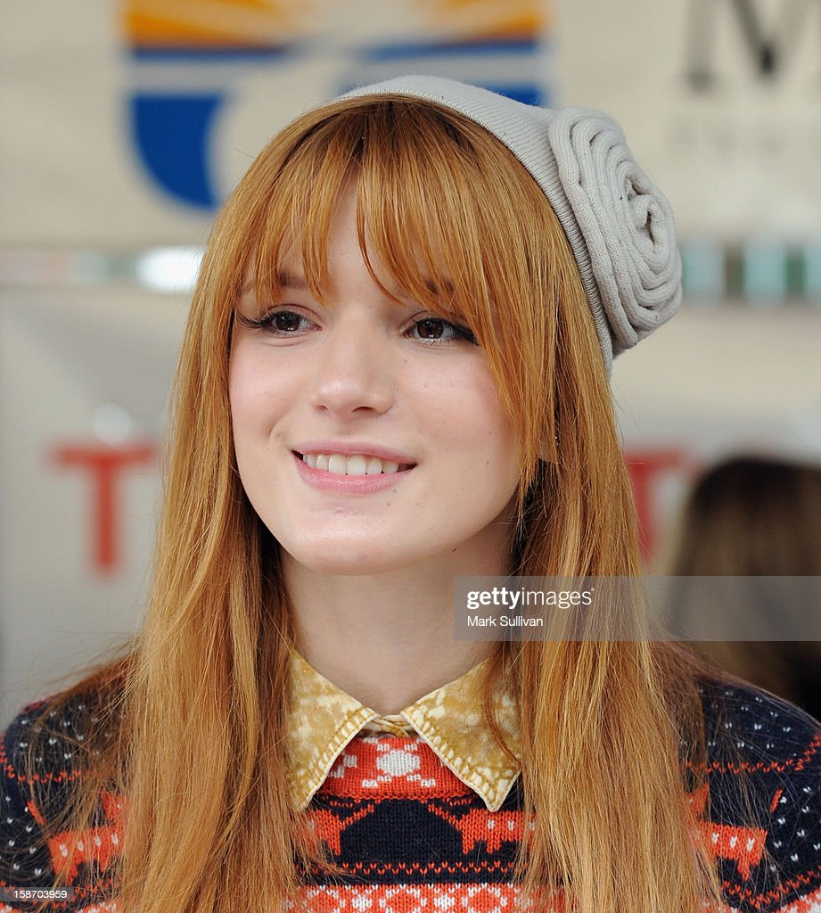 Actress <a gi-track='captionPersonalityLinkClicked' href=/galleries/search?phrase=Bella+Thorne&family=editorial&specificpeople=5083663 ng-click='$event.stopPropagation()'>Bella Thorne</a> serves food during the Los Angeles Mission Christmas Eve meal for the homeless at Los Angeles Mission on December 24, 2012 in Los Angeles, California.