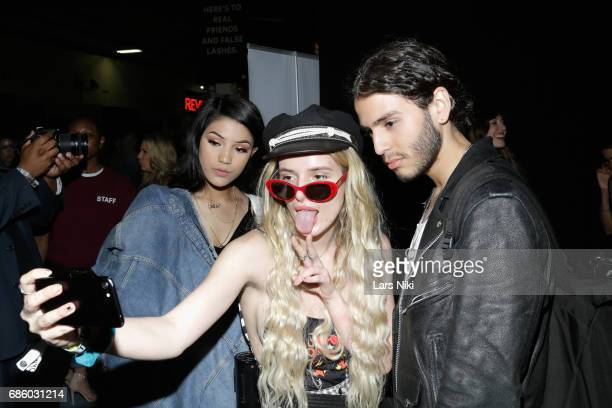 Actress Bella Thorne takes a selfie with fans during Beautycon Festival NYC 2017 at Brooklyn Cruise Terminal on May 20 2017 in New York City