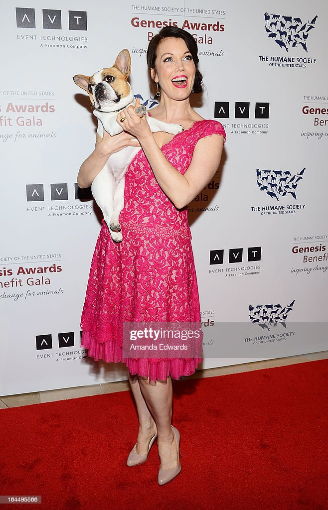 Actress Bellamy Young and Beatrice the dog arrive at The Humane Society's 2013 Genesis Awards Benefit Gala at The Beverly Hilton Hotel on March 23, 2013 in Beverly Hills, California.