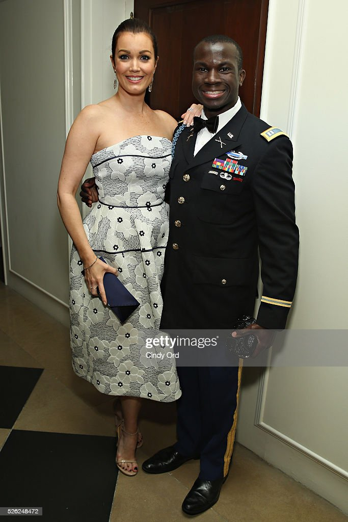 Actress <a gi-track='captionPersonalityLinkClicked' href=/galleries/search?phrase=Bellamy+Young&family=editorial&specificpeople=4135230 ng-click='$event.stopPropagation()'>Bellamy Young</a> poses for a photo with Invictus Games medalist, Army Captain William Reynolds as Jaguar Land Rover sponsor Capitol File's White House Correspondents' Dinner Party on April 30, 2016 in Washington, DC.