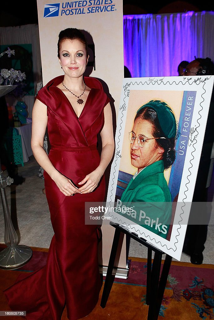 Actress Bellamy Young previews the Rosa Parks Forever Stamp in the U.S. Postal Service Civil Rights Stamp Gallery backstage at the NAACP Image Awards on February 1, 2013 at The Shrine Auditorium.
