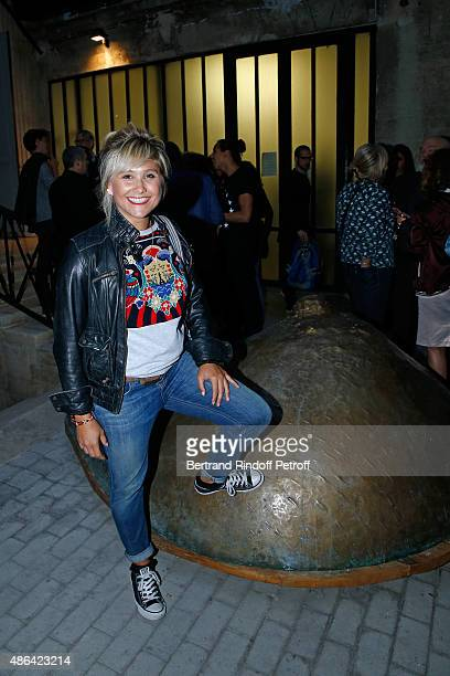 Actress Berengere Krief poses in front of a Cesar's work during the 'World Press Photo 2015' Exhibition Opening Party held at Galerie Azzedine Alaïa...