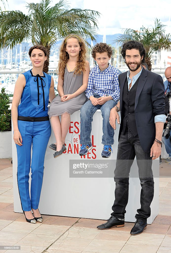 Actress Berenice Bejo, actress Jeanne Jestin, actor Elyes Aguis and actor <a gi-track='captionPersonalityLinkClicked' href=/galleries/search?phrase=Tahar+Rahim&family=editorial&specificpeople=5856944 ng-click='$event.stopPropagation()'>Tahar Rahim</a> attend 'Le Passe' photocall during the 66th Annual Cannes Film Festival at the Palais des Festivals on May 17, 2013 in Cannes, France.