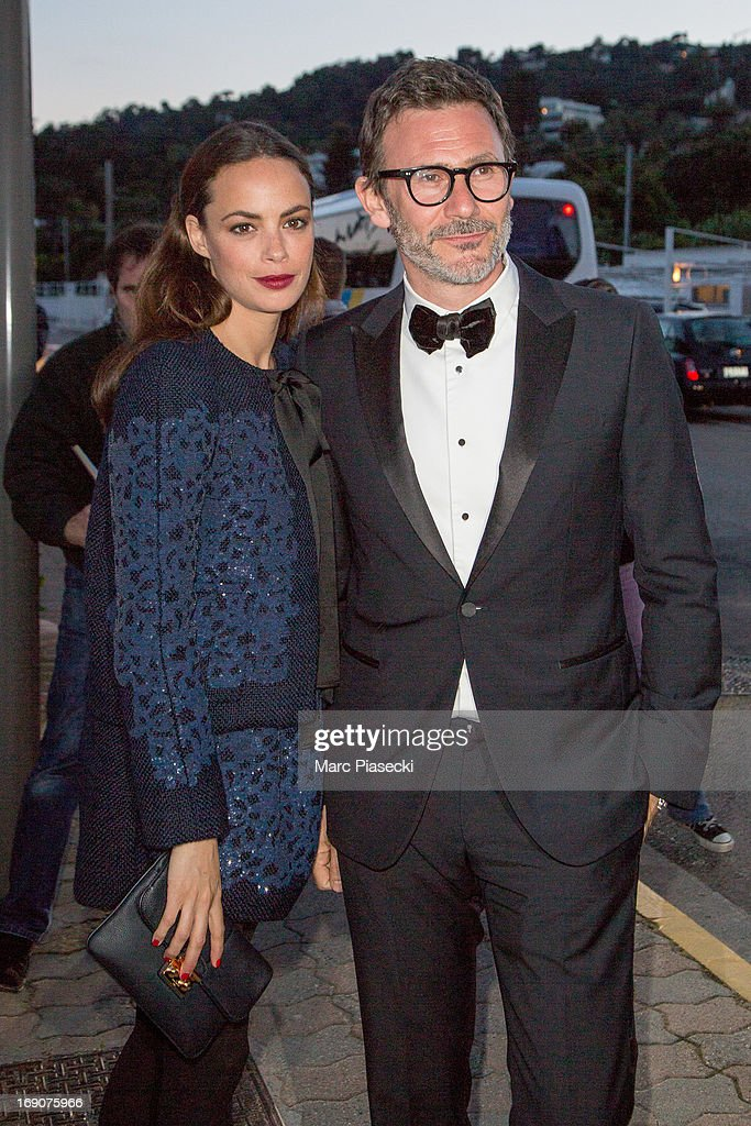 Actress Berenice Bejo and director <a gi-track='captionPersonalityLinkClicked' href=/galleries/search?phrase=Michel+Hazanavicius&family=editorial&specificpeople=678372 ng-click='$event.stopPropagation()'>Michel Hazanavicius</a> arrive to attend the 'Vanity Fair Chanel' dinner at 'Tetou' restaurant during the 66th Annual Cannes Film Festival on May 19, 2013 in Le Golfe Juan, France.