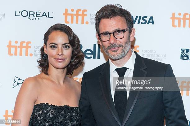 Actress Berenice Bejo and director Michel Hazanavicius attend 'The Search' premiere during the Toronto International Film Festival at The Elgin on...