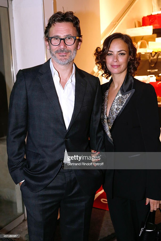 Actress Berenice Bejo (R) and Director <a gi-track='captionPersonalityLinkClicked' href=/galleries/search?phrase=Michel+Hazanavicius&family=editorial&specificpeople=678372 ng-click='$event.stopPropagation()'>Michel Hazanavicius</a> (both wearing Louis Vuitton) attend the Annual Charity Dinner hosted by the AEM Association Children of the World for Rwanda on December 17, 2013. Held at Espace Pierre Cardin in Paris, France.