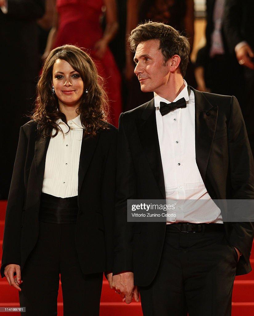 Actress Berenice Bejo (L) and director Michel Hazanavicius depart 'The Artist' premiere at the Palais des Festivals during the 64th Annual Cannes Film Festival on May 15, 2011 in Cannes, France.