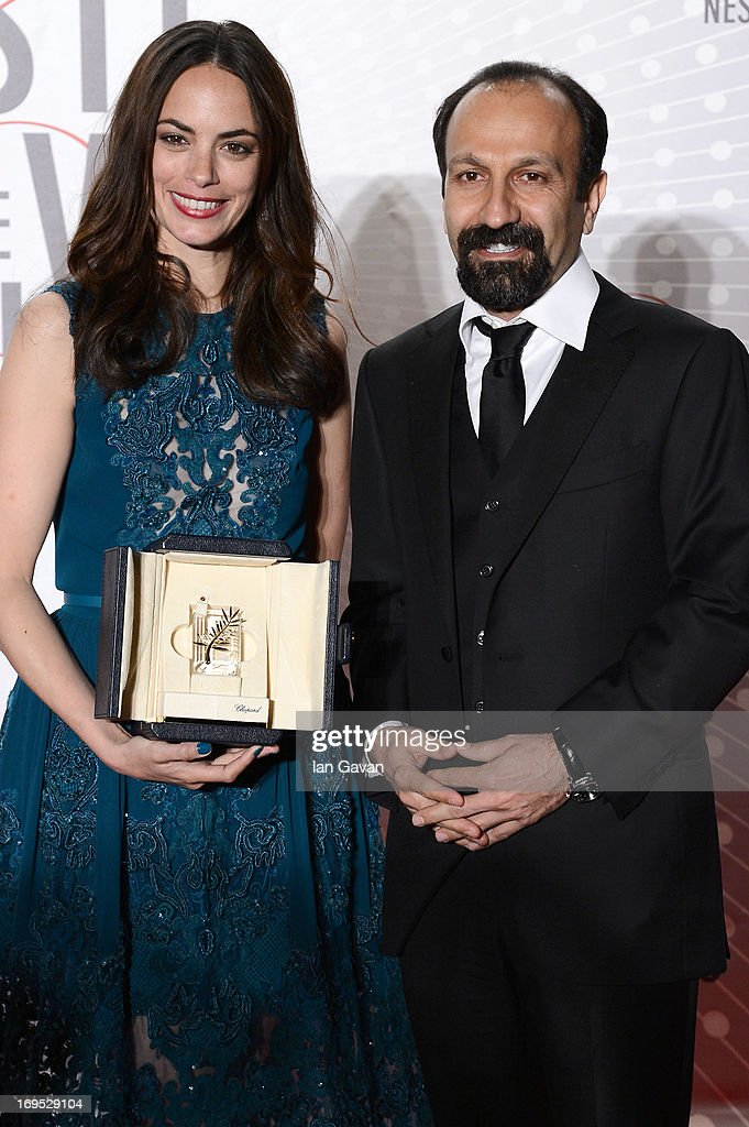 Actress Berenice Bejo, awarded with the Prix d'Interpretation Feminine (Best Actress), and director <a gi-track='captionPersonalityLinkClicked' href=/galleries/search?phrase=Asghar+Farhadi&family=editorial&specificpeople=5700577 ng-click='$event.stopPropagation()'>Asghar Farhadi</a> attend he Palme D'Or Winners dinner during The 66th Annual Cannes Film Festival at Agora on May 26, 2013 in Cannes, France.