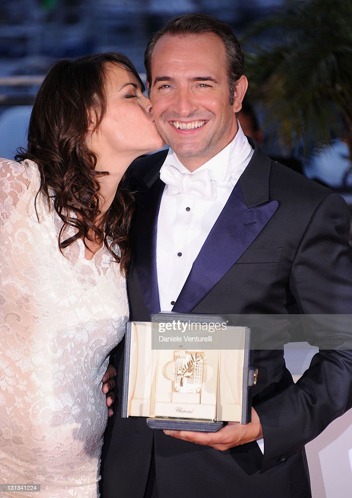 Actress Berenice Bejo congratulates Jean Dujardin after he receives the Award for Best Actor for the film 'The Artist' during the Palme D'Or Winners Photocall at the 64th Annual Cannes Film Festival at the Palais des Festivals on May 22, 2011 in Cannes, France.