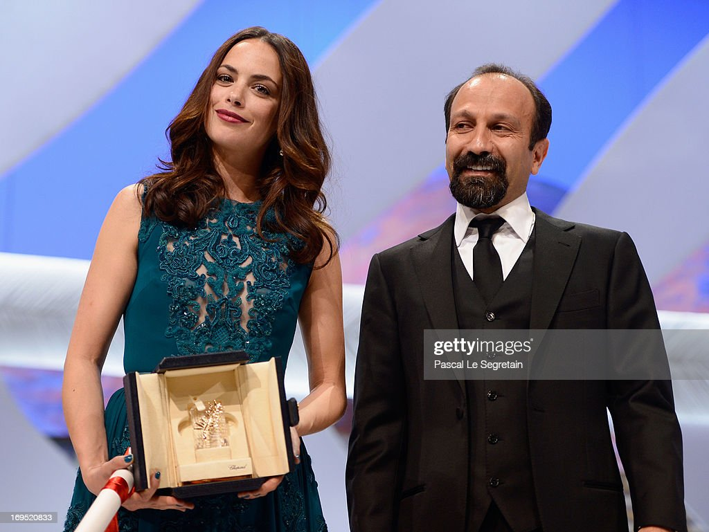 Actress Berenice Bejo poses with director <a gi-track='captionPersonalityLinkClicked' href=/galleries/search?phrase=Asghar+Farhadi&family=editorial&specificpeople=5700577 ng-click='$event.stopPropagation()'>Asghar Farhadi</a> after being awarded with the Prix d'Interpretation Feminine (Best Actress) at the Inside Closing Ceremony during the 66th Annual Cannes Film Festival at the Palais des Festivals on May 26, 2013 in Cannes, France.