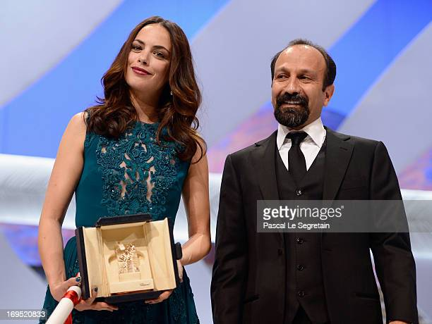 Actress Berenice Bejo poses with director Asghar Farhadi after being awarded with the Prix d'Interpretation Feminine at the Inside Closing Ceremony...