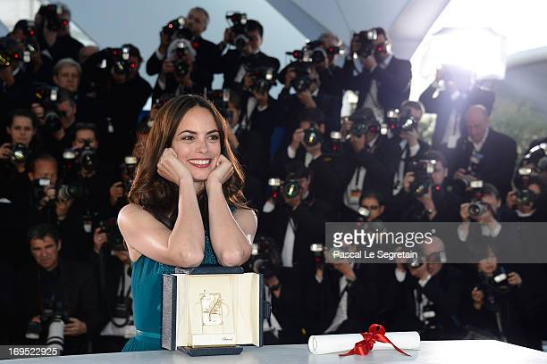 Actress Berenice Bejo poses with the Prix d'Interpretation Feminine attends the Palme D'Or Winners Photocall during the 66th Annual Cannes Film...