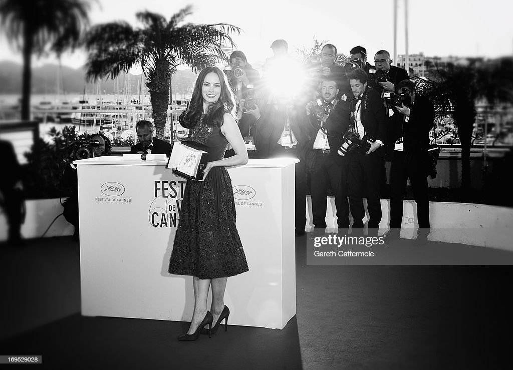 Actress Berenice Bejo poses with the Prix d'Interpretation Feminine (Best Actress) attends the Palme D'Or Winners Photocall during the 66th Annual Cannes Film Festival at the Palais des Festivals on May 26, 2013 in Cannes, France.