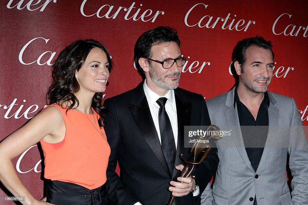Actress Berenice Bejo, writer/director Michel Hazanavicius, winner of the Sonny Bono Visionary Award, and actor Jean Dujardin attend The 23rd Annual Palm Springs International Film Festival Awards Gala at the Palm Springs Convention Center on January 7, 2012 in Palm Springs, California.