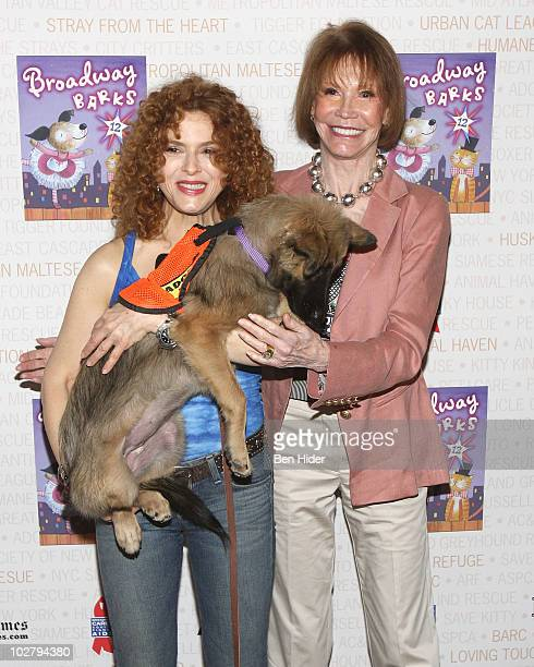 Actress Bernadette Peters and Mary Tyler Moore attend the 12th annual Broadway Barks in Shubert Alley on July 10 2010 in New York City