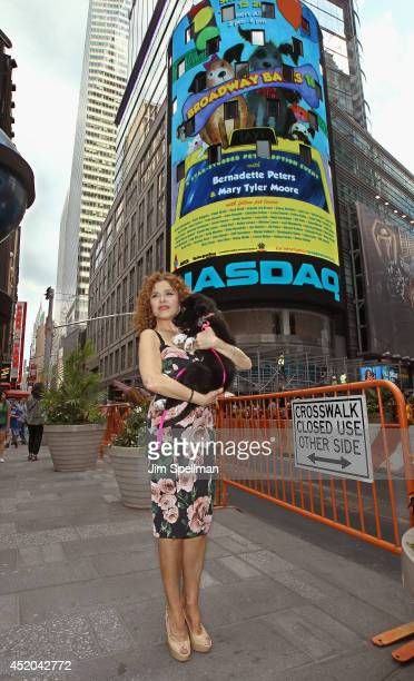 Actress Bernadette Peters rings the closing bell at NASDAQ MarketSite on July 11 2014 in New York City