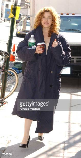 Actress Bernadette Peters walks through the movie set for the new film 'Smack in the Kisser' March 21 2002 in New York City The film also stars Kirk...
