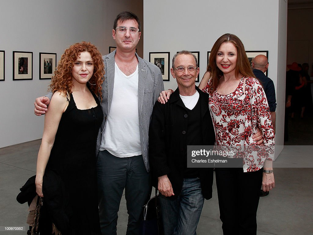 Actress Bernette Peters, playwright Jon Robin Baitz and actors Joel Grey and Donna Murphy attend the photography exhibition opening for '1.3: New Color Images by Joel Grey' at Steven Kasher Gallery on May 25, 2010 in New York City.
