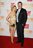 Actress Beth Behrs and actor Michael Gladis attend TrevorLIVE Los Angeles at the Hollywood Palladium on December 7 2014 in Los Angeles California
