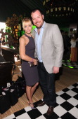 Actress Beth Behrs and actor Michael Gladis visit the Jameson tent at the 2012 Film Independent Spirit Awards at Santa Monica Pier on February 25...