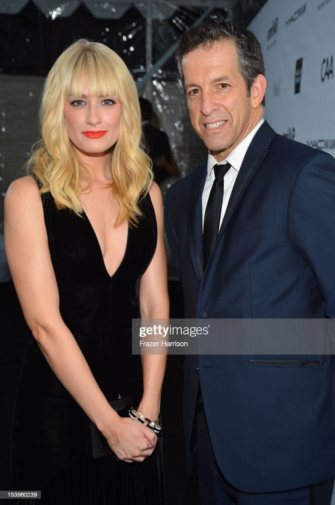 Actress <a gi-track='captionPersonalityLinkClicked' href=/galleries/search?phrase=Beth+Behrs&family=editorial&specificpeople=6556378 ng-click='$event.stopPropagation()'>Beth Behrs</a> (L) and Designer/amFAR Chairman Kenneth Cole arrive at amfAR's Inspiration Gala at Milk Studios on October 11, 2012 in Los Angeles, California.