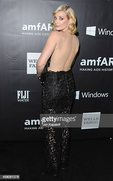 Actress Beth Behrs arrives at the 2014 amfAR LA Inspiration Gala at Milk Studios on October 29 2014 in Hollywood California