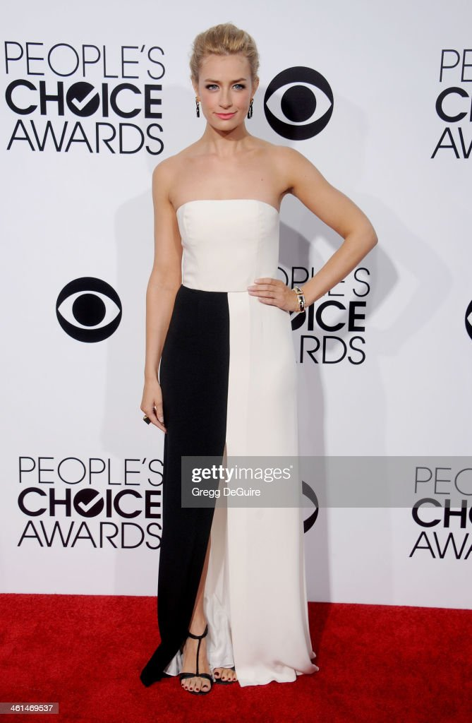 Actress <a gi-track='captionPersonalityLinkClicked' href=/galleries/search?phrase=Beth+Behrs&family=editorial&specificpeople=6556378 ng-click='$event.stopPropagation()'>Beth Behrs</a> arrives at the 40th Annual People's Choice Awards at Nokia Theatre LA Live on January 8, 2014 in Los Angeles, California.