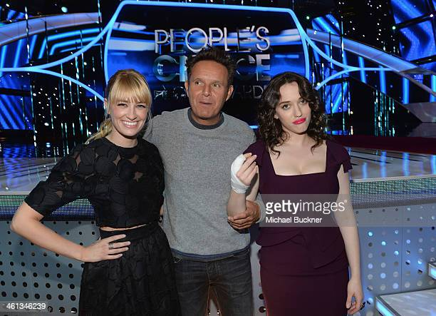 Actress Beth Behrs producer Mark Burnett and actress Kat Dennings pose in front of the stage for the 2014 People's Choice Awards at Nokia Theatre LA...