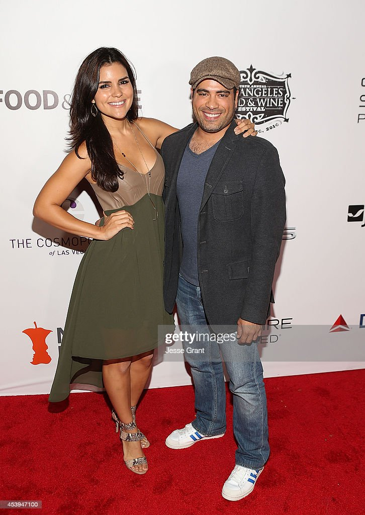 Actress Betsy Landin and actor Sevier Crespo attend Ultimate Bites of L.A. Presented by Chase Sapphire Preferred, Hosted by Chef Graham Elliot & Fabio Viviani on August 21, 2014 in Los Angeles, California.