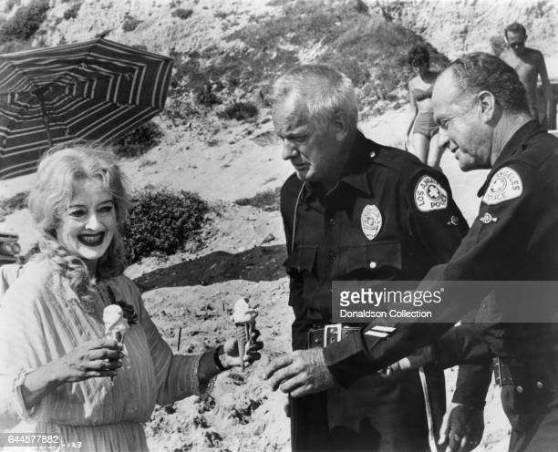 Actress Bette Davis as Baby Jane Hudson and actors Russ Conway and James Seay in a publicity still for the Warner Bros film 'What Ever Happened to...