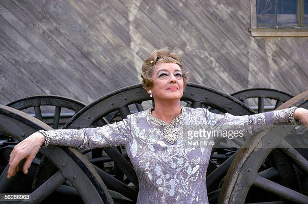 American actress Bette Davis on the set during filming of the episode 'Touch of Magic' in the television series 'It Takes A Thief' December 1970