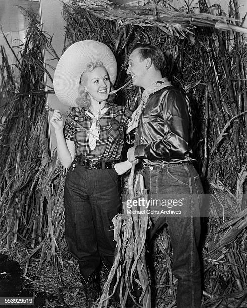 Actress Betty Grable and husband actor Jackie Coogan attend a party in Los Angeles California