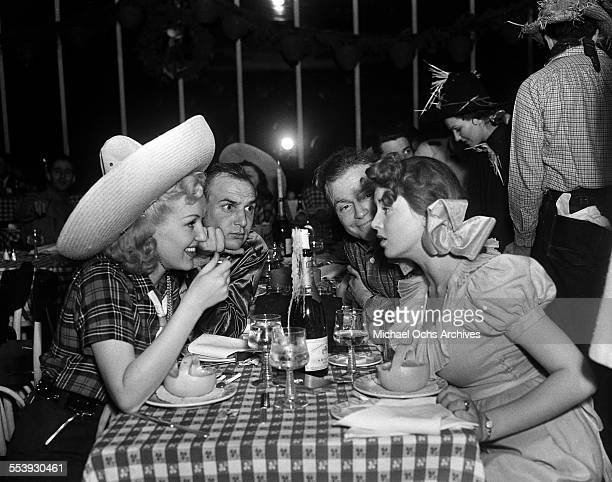 Actress Betty Grable and husband actor Jackie Coogan attend a party with actor Red Skelton and wife Edna Skelton in Los Angeles California