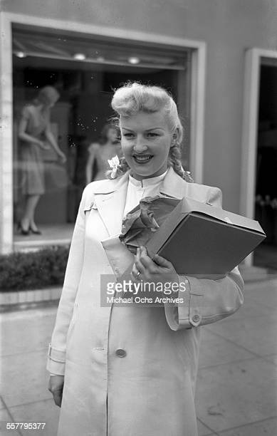 Actress Betty Grable poses on a street in Los Angeles California