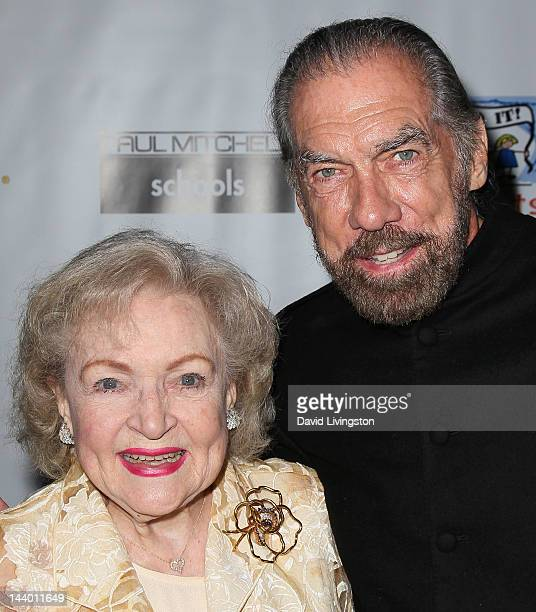 Actress Betty White and Paul Mitchell CEO John Paul DeJoria attend Paul Mitchell's 9th Annual Fundraiser at the Beverly Hilton on May 7 2012 in...