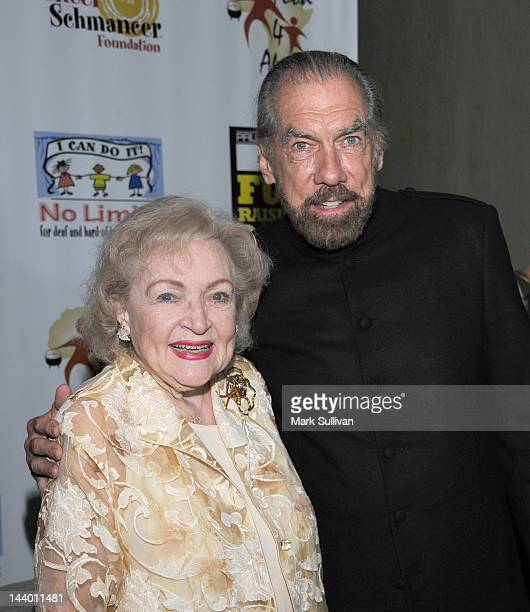 Actress Betty White and Paul Mitchell CEO John Paul DeJoria attends Paul Mitchell's 9th Annual Fundraiser at The Beverly Hilton Hotel on May 7 2012...
