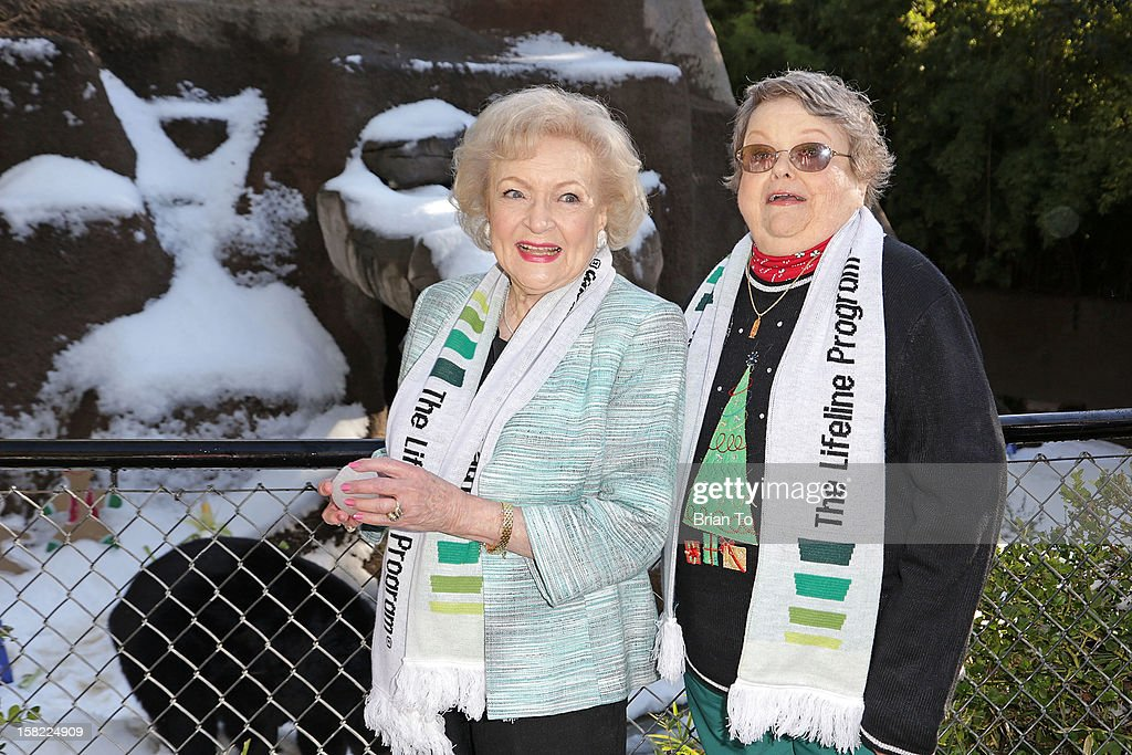 Actress Betty White and winner of The Lifeline Program's national 'Bucket List' Facebook contest Leslie Scott attend Betty 'White Out' Tour at The Los Angeles Zoo with The Lifeline Program at Los Angeles Zoo on December 11, 2012 in Los Angeles, California.
