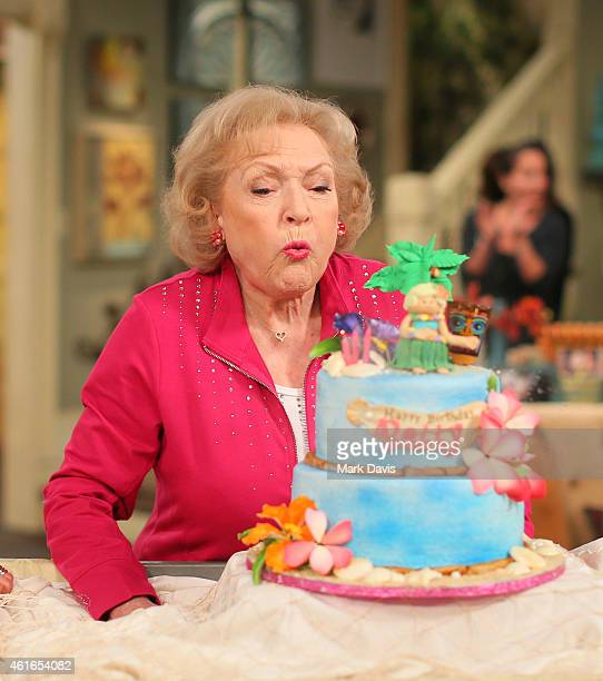 Actress Betty White poses at the celebration of her 93rd birthday on the set of 'Hot in Cleveland' held at CBS Studios Radford on January 16 2015 in...