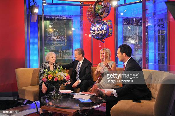 Actress Betty White Steve Doocy Gretchen Carlson and Brian Kilmeade visit 'Fox Friends' at FOX Studios on January 19 2011 in New York City
