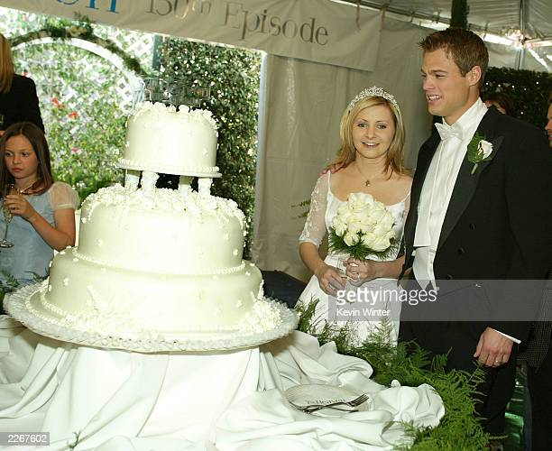 Actress Beverley Mitchell and actor George Stults who marry in a future episode at a reception to celebrate 150 episodes of The WB's '7th Heaven' on...